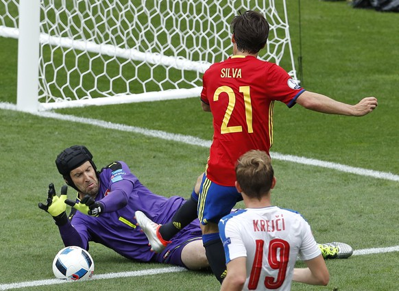 Czech Republic goalkeeper Petr Cech saves at the feet of Spain's David Silva during the Euro 2016 Group D soccer match between Spain and the Czech Republic at the Stadium municipal in Toulouse, France, Monday, June 13, 2016. (AP Photo/Hassan Ammar)
