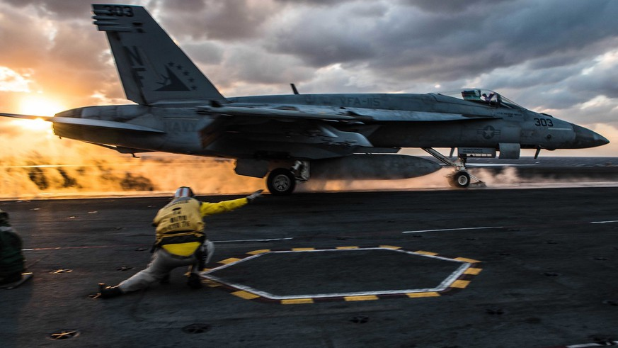 epa06325865 A handout photo made available by the US Navy on 13 November 2017 shows an F/A-18E Super Hornet of Strike Fighter Squadron (VFA) 115 launching from the flight deck of the Navy's forward-deployed aircraft carrier, USS Ronald Reagan (CVN 76) in the western Pacific Ocean, at sea, 11 November 2017. Aircraft carriers, Theodore Roosevelt, Ronald Reagan, and Nimitz strike groups are underway conducting flight operations in international waters as part of a three-carrier strike force exercise.  EPA/US NAVY/MC2 JANWEB B. LAGAZO HANDOUT  HANDOUT EDITORIAL USE ONLY/NO SALES