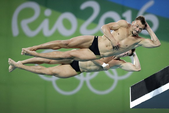 Germany's Sascha Klein, top, and Patrick Hausding compete in the men's synchronized 10-meter platform diving final in the Maria Lenk Aquatic Center at the 2016 Summer Olympics in Rio de Janeiro, Brazil, Monday, Aug. 8, 2016. (AP Photo/Wong Maye-E)