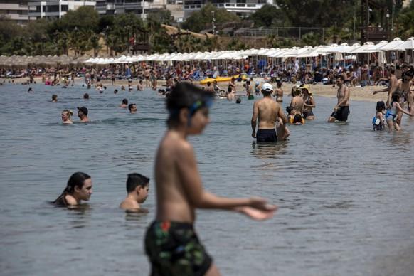 Virus Outbreak Greece Beaches