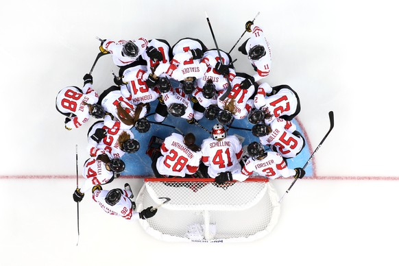 SOCHI, RUSSIA - FEBRUARY 10:  Switzerland players talk in a huddle before the Women's Ice Hockey Preliminary Round Group A game on day three of the Sochi 2014 Winter Olympics at Shayba Arena on February 10, 2014 in Sochi, Russia.  (Photo by Martin Rose/Getty Images)
