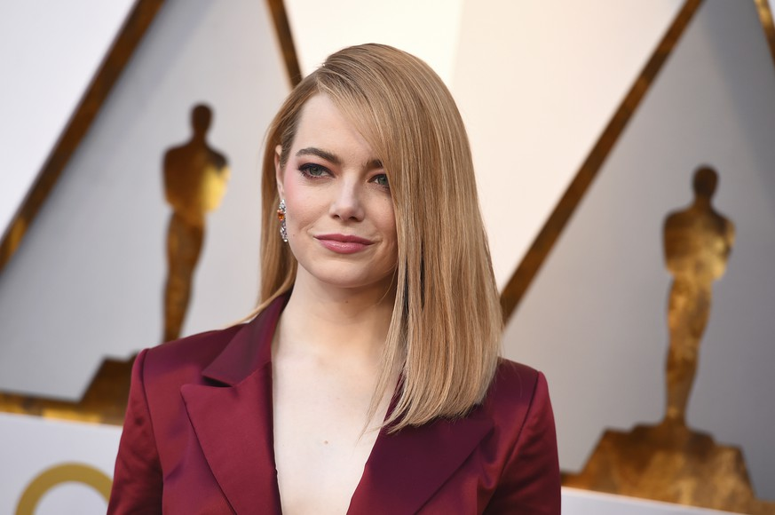 FILE - In this March 4, 2018, file photo, Emma Stone arrives at the Oscars in Los Angeles. Emma Stone plays Annie Landsberg and Jonah Hill plays Owen Milgrim in