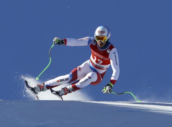 Switzerland's Carlo Janka competes in an alpine ski, men's World Cup Super G race, in Kitzbuehel, Austria, Friday, Jan. 20, 2017. (AP Photo/Alessandro Trovati)