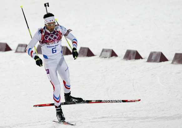 France's Martin Fourcade competes during the men's biathlon 12.5k pursuit, at the 2014 Winter Olympics, Monday, Feb. 10, 2014, in Krasnaya Polyana, Russia. (AP Photo/Felipe Dana)