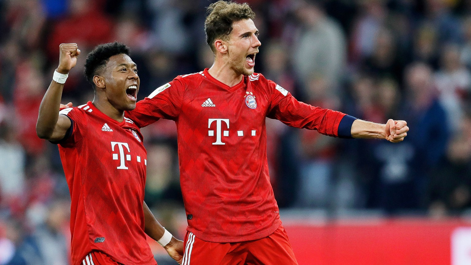 epa07489333 Bayern players David Alaba (L) and Leon Goretzka (R) celebrate after winning the German Bundesliga soccer match between FC Bayern Munich and Borussia Dortmund in Munich, Germany, 06 April 2019.  EPA/RONALD WITTEK CONDITIONS - ATTENTION: The DFL regulations prohibit any use of photographs as image sequences and/or quasi-video.