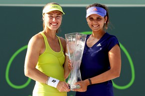 KEY BISCAYNE, FL - APRIL 05:  Martina Hingis of Switzerland and Sania Mirza of India pose with the Butch Buchholz Trophy after defeating Ekaterina Makarova and Elena Vesnina of Russia during the doubles final on day 14 of the Miami Open Presented by Itau at Crandon Park Tennis Center on April 5, 2015 in Key Biscayne, Florida.  (Photo by Matthew Stockman/Getty Images)