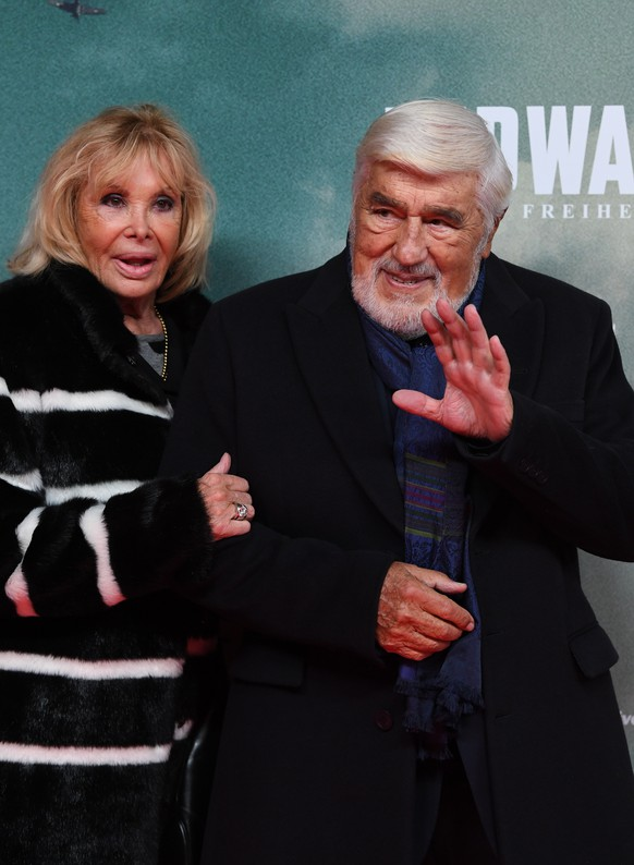 epa07947257 German actor Mario Adorf (R) and his wife Monique Faye arrive for the premiere of the film 'Midway' in Munich, Germany, 24 October 2019. The movie opens across German theaters on 07 November.  EPA/Andreas Gebert