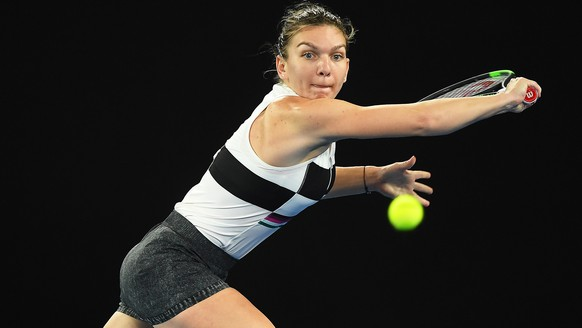 epa07292012 Simona Halep of Romania in action against Sofia Kenin of the USA during their women's second round match of the Australian Open Grand Slam tennis tournament in Melbourne, Australia, 17 January 2019.  EPA/JULIAN SMITH AUSTRALIA AND NEW ZEALAND OUT