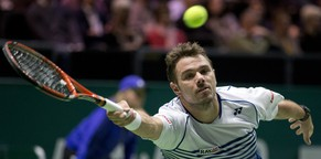 Stan Wawrinka of Switzerland returns the ball to Jesse Huta Galung of the Netherlands during their first round match of the 42nd ABN AMRO world tennis tournament at Ahoy Arena in Rotterdam, Netherlands, Wednesday, Feb. 11, 2015. (AP Photo/Peter Dejong)