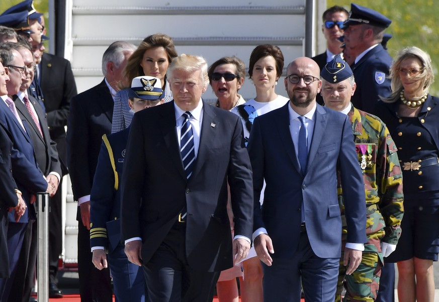 US President Donald Trump and Belgian Prime Minister Charles Michel walk together during arrival at Melsbroek Military Airport in Melsbroek, Belgium on Wednesday, May 24, 2017. US President Donald Trump is in Belgium to attend a NATO summit and to meet EU and Belgian officials. (AP Photo/Geert Vanden Wijngaert)