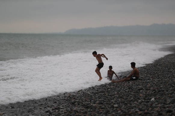 epa07781002 People spend time on the beach in Batumi, Georgia, 19 August 2019. Batumi is a seaside resort on the Black Sea coast in southwest Georgia.  EPA/ZURAB KURTSIKIDZE