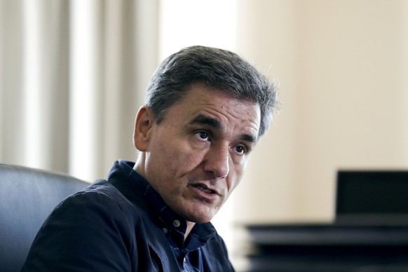 """Greek Deputy Foreign Minister and coordinator of the negotiating team for the talks between Greece and its international lenders, Euclid Tsakalotos, speaks during an interview with Reuters at his ministerial office in Athens June 17, 2015. Greece is willing to make concessions to strike a deal with creditors as long as it is """"economically viable"""", but will not cut its existing pensions, a top Greek negotiator told Reuters on Wednesday. The comments by Euclid Tsakalotos were the clearest sign since the collapse of talks at the weekend that Greece still has room to offer some ground to lenders despite its hardline rhetoric against their demands.REUTERS/Alkis Konstantinidis"""