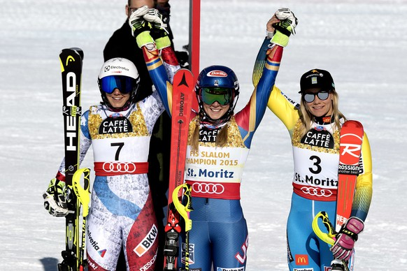 Silver medalist Wendy Holdener, of Switzerland, left, Gold medalist Mikaela Shiffrin, of the U.S.A., center, and Bronze medalist Frida Hansdotter, of Sweden, celebrate, during the flower ceremony of the women's  slalom at the 2017 Alpine Skiing World Championships in St. Moritz, Switzerland, Saturday, Feb. 18, 2017. (Peter Schneider/Keystone via AP)