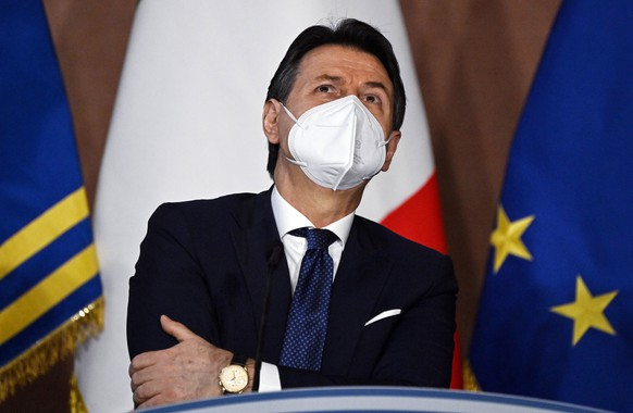 epa08911296 Italian premier Giuseppe Conte reacts during the year-end press conference organized by the Order of Journalists (ODG) at Villa Madama, Rome, Italy, 30 December 2020.  EPA/Riccardo Antimiani