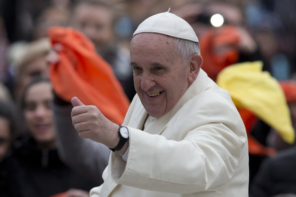 Pope Francis gives the thumbs up as he arrives on his pope-mobile for his weekly general audience in St. Peter's Square at the Vatican, Wednesday, Feb. 12, 2014. (AP Photo/Alessandra Tarantino)