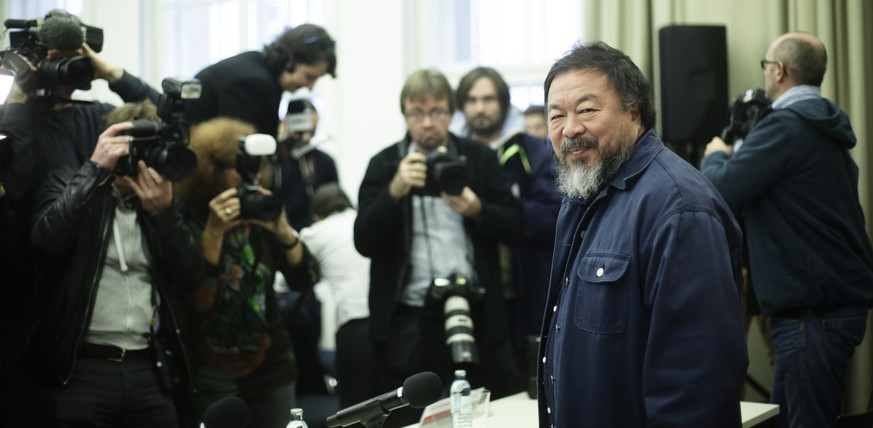 Chinese artist Ai Weiwei arrives for a news conference about his Einstein Professorship at the University Of Arts (UDK)   in Berlin, Monday, Oct. 26, 2015. Ai Weiwei will be starting teaching at the University in the winter semester of 2015-16. (AP Photo/Markus Schreiber)