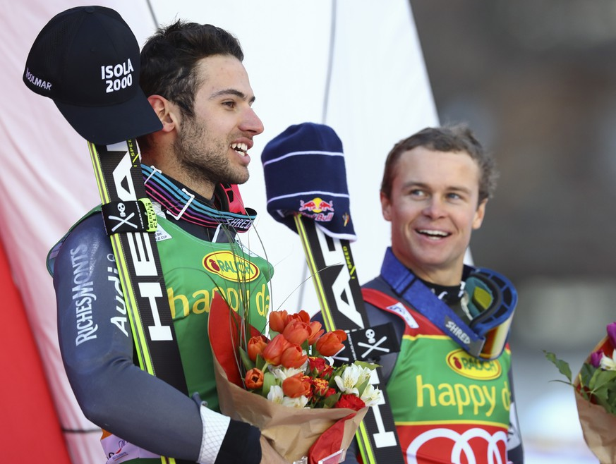 France's Mathieu Faivre, left, winner of an alpine ski, men's World Cup giant slalom, poses with third placed France's Alexis Pinturault, in Val d'Isere, France, Sunday, Dec. 4, 2016. (AP Photo/Alessandro Trovati)