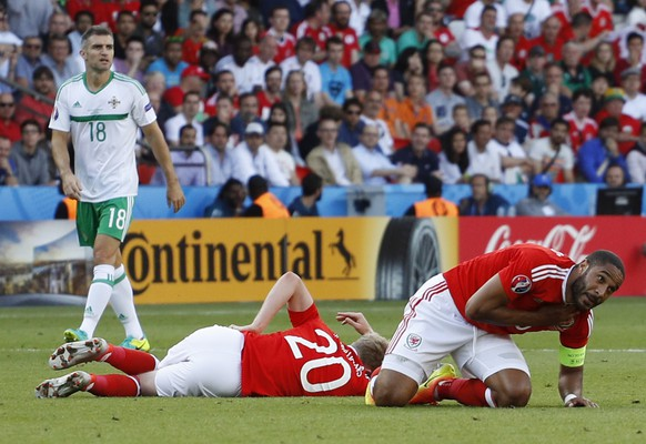 Football Soccer - Wales v Northern Ireland - EURO 2016 - Round of 16 - Parc des Princes, Paris, France - 25/6/16 Wales' Ashley Williams and Jonathan Williams sustaining injuries after colliding REUTERS/Darren Staples Livepic