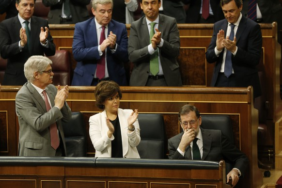 Spain's Prime Minister Mariano Rajoy, bottom right is applauded by members of his party during the second day of a motion of no confidence session at the Spanish parliament in Madrid, Friday, June 1, 2018. Socialist opposition leader Pedro Sanchez is on the brink of ending Mariano Rajoy's more than six-year reign as Spanish prime minister in what would be the first ouster of a serving leader by parliament in four decades of democracy as Spain's conservative government appears doomed to lose a no-confidence vote in parliament(AP Photo/Francisco Seco)
