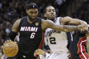 Miami Heat forward LeBron James (6) tries to get past San Antonio Spurs forward Kawhi Leonard (2) during the first half in Game 5 of the NBA basketball finals on Sunday, June 15, 2014, in San Antonio. (AP Photo/David J. Phillip)