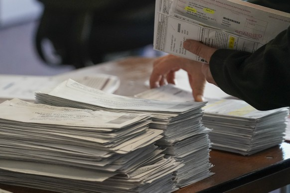 Workers count Milwaukee County ballots on Election Day at Central Count on Tuesday, Nov. 3, 2020, in Milwaukee. (AP Photo/Morry Gash)