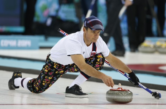 Norway skip Thomas Ulsrud, wearing rose-painting knickers and a patterned flat cap, delivers the stone during curling training at the 2014 Winter Olympics, Saturday, Feb. 8, 2014, in Sochi, Russia. (AP Photo/Robert F. Bukaty)