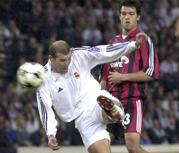 Real Madrid's Zinedine Zidane scores the winning goal watched by Bayer Leverkusen's Michael Ballack during the UEFA Champions League final at Hampden Park in Glasgow, Scotland Wednesday May 15, 2002. Real Madrid won the match 2-1. (AP Photo) ** UNITED KINGDOM OUT **