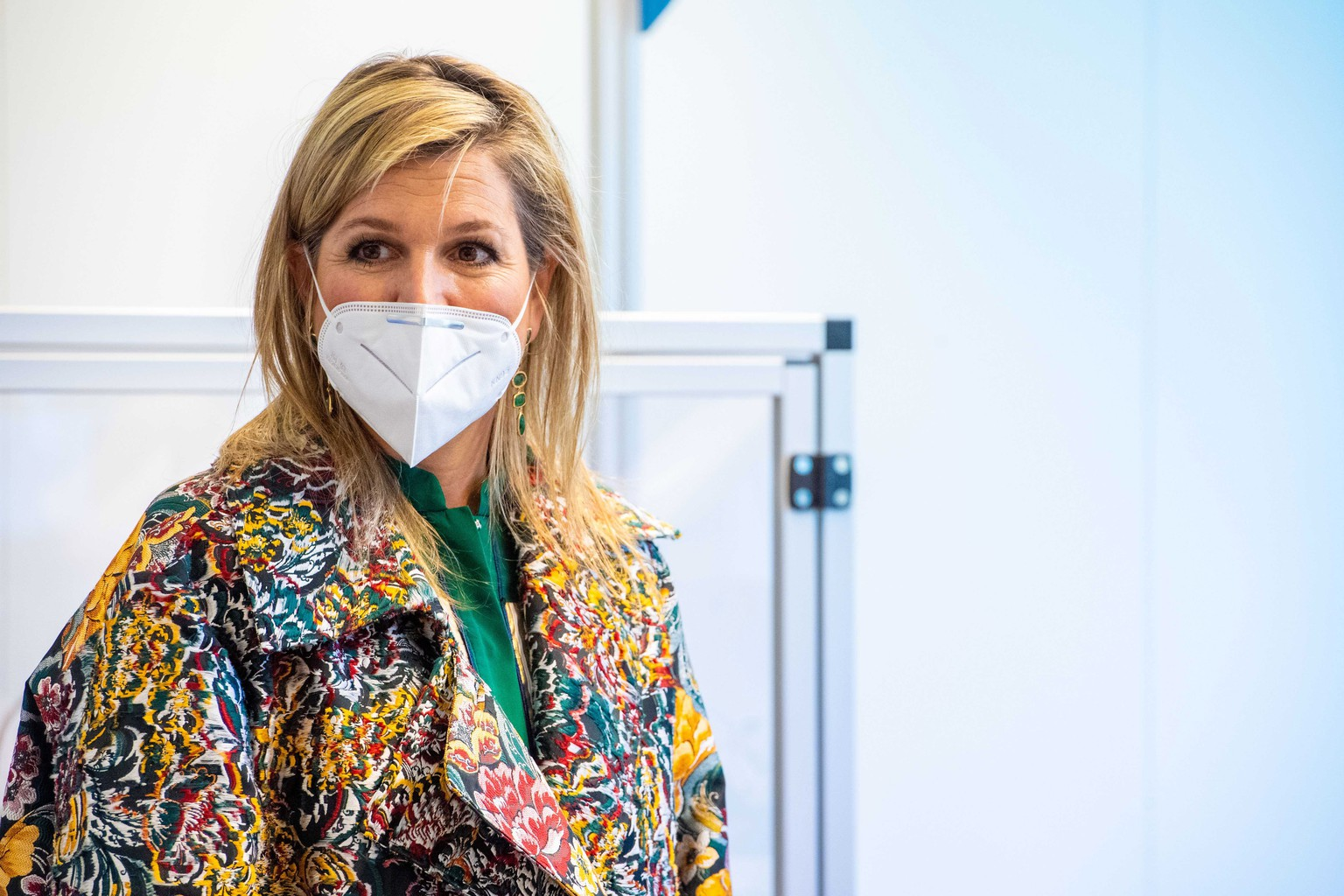 epa08366845 Dutch Queen Maxima wears a protective face mask during a working visit to technology company Demcon in Enschede, The Netherlands, 16 April 2020. The company has developed, tested and produced a ventilation system suitable for the ventilation of corona patients in intensive care.  EPA/MISCHA SCHOEMAKER / POOL