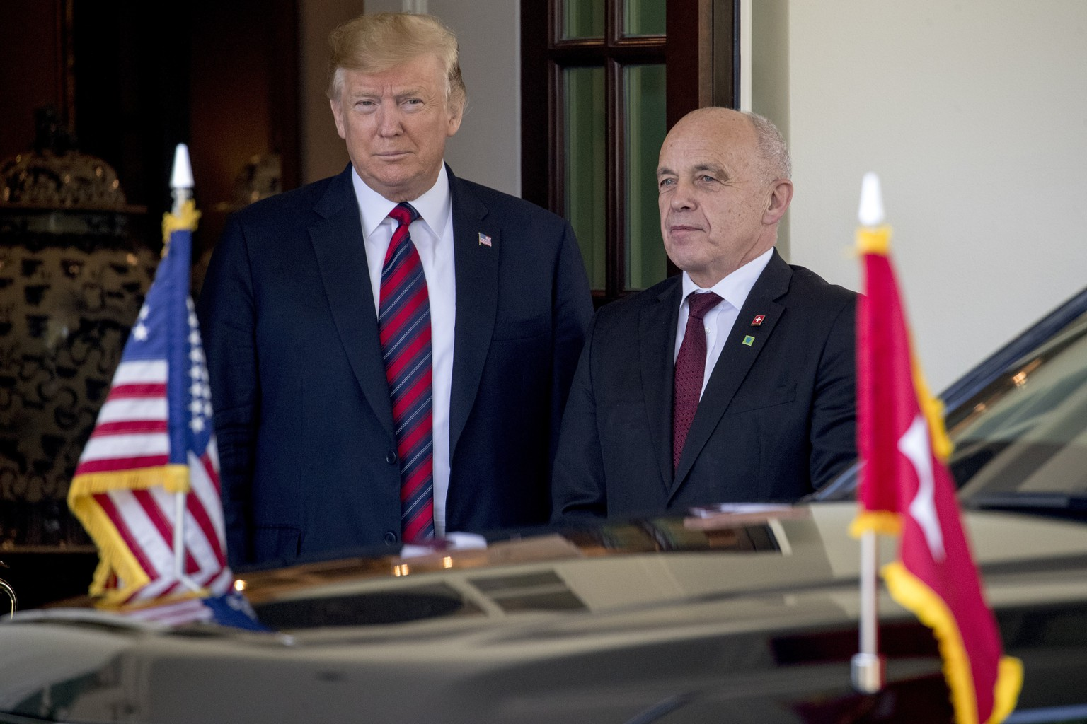President Donald Trump welcomes Switzerland's Federal President Ueli Maurer, right, to the White House, Thursday, May 16, 2019, in Washington. (AP Photo/Andrew Harnik)