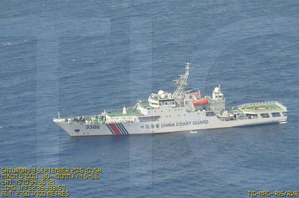 epa05528550 A watermarked image provided by the Philippines Department of National Defense (DND) Public Affairs Service released on 07 September 2016 shows picture of one of many Chinese vessels (with coordinates diplayed on the photo), that was filmed during an overflight by a Philippine Air Force plane at the vicinity of the Scarborough Shoal on the waters of South China Sea, Philippine territory, on 03 September 2016. The Philippine defense ministry released nearly a dozen of photos on 07 September of Chinese ships in the South China Sea area disputed between Manila and Beijing, hours ahead of a meeting between countries of Southeast Asia and China at a summit in Laos. According to a map accompanying the photos, the ships - some of them belonging to the Chinese Coast Guard - are seen in the area surrounding the Scarborough Shoal. The Shoal is roughly 200 kilometers from the Philippine coast and Manila says it is part of its exclusive economic zone. The publication of the photos comes a few days after the Philippines expressed concern over spotting several boats in the region. Philippine Defense Minister Delfin Lorenzana said the presence of so many boats near the Coast Guard in the area is of serious concern, adding the ministry has already sought an explanation from the Chinese ambassador in Manila.  EPA/DND HANDOUT BEST QUALITY AVAILABLE HANDOUT EDITORIAL USE ONLY/NO SALES