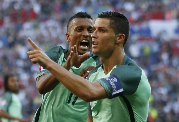 Football Soccer - Hungary v Portugal - EURO 2016 - Group F - Stade de Lyon, Lyon, France - 22/6/16Portugal's Cristiano Ronaldo celebrates after scoring their second goal with NaniREUTERS/Robert PrattaLivepic