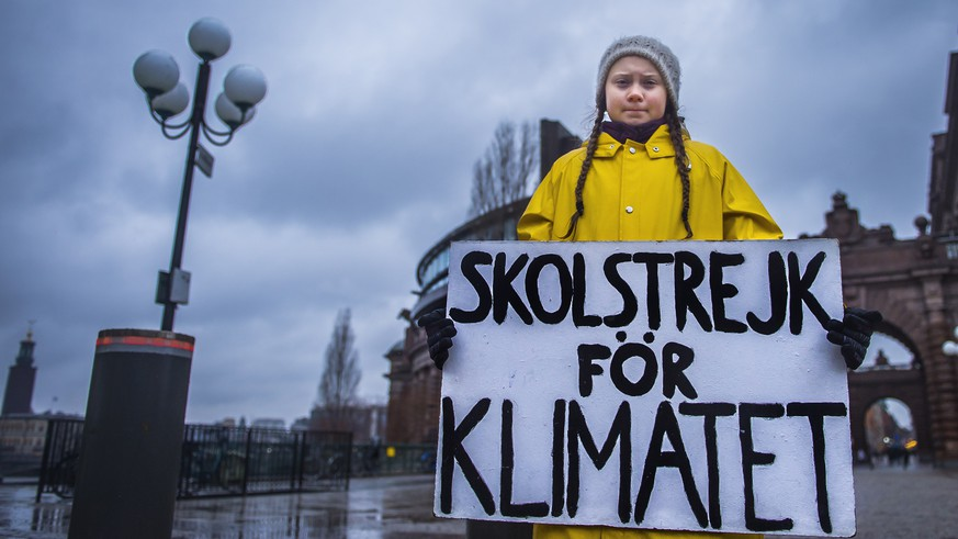 epaselect epa07199174 Swedish 15-year-old girl Greta Thunberg holds a placard reading 'School strike for the climate', during a protest against climate change outside the Swedish parliament in Stockholm, 30 November 2018. Climate change protests are planned for 30 November across cities around Sweden, partly inspired by Greta Thunberg, who protests on every Friday against climate change outside the parliament since several months. UN's annual climate talks which this year will take place in Poland starts on 02 December.  EPA/HANNA FRANZEN SWEDEN OUT