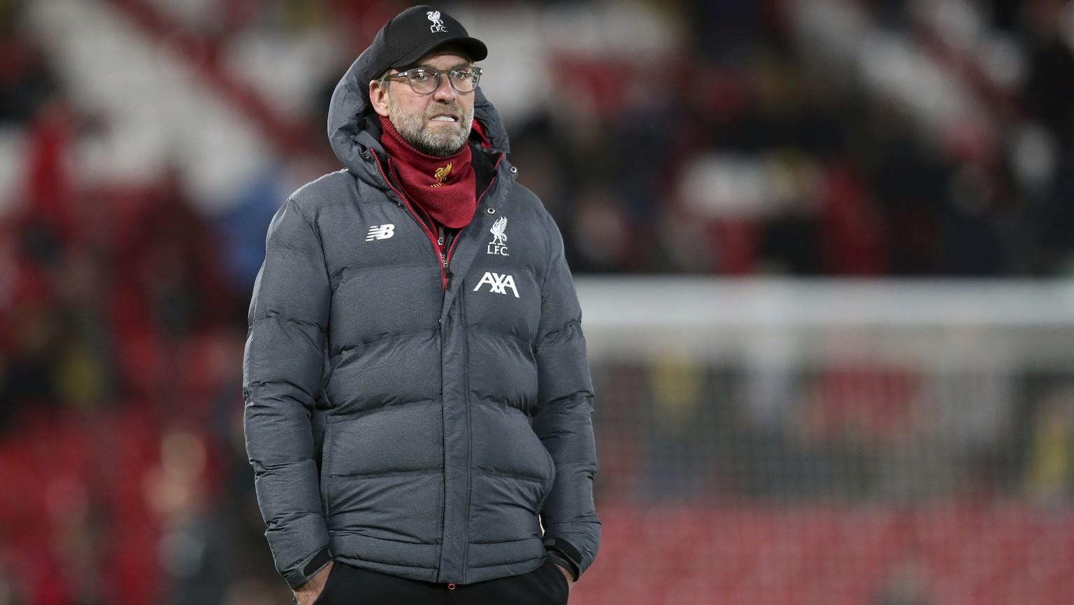 Liverpool's manager Jurgen Klopp looks on warm up before the English League Cup soccer match between Liverpool and Arsenal at Anfield stadium in Liverpool, England, Wednesday, Oct. 30, 2019. (AP Photo/Jon Super)