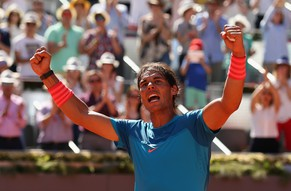 MADRID, SPAIN - MAY 09:  Rafael Nadal of Spain celebrates to the crowd after his straight sets victory against Tomas Berdych of the Czech Republic in their semi final match during day eight of the Mutua Madrid Open tennis tournament at the Caja Magica  on May 9, 2015 in Madrid, Spain.  (Photo by Clive Brunskill/Getty Images)