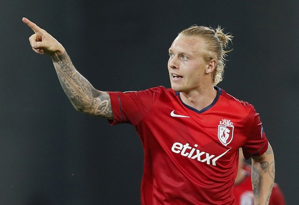 Lille's Simon Kjaer celebrates his goal against Krasnodar during their Europa League soccer match at the Lille Metropole Grand Stade stadium in Villeneuve d'Ascq, September 18, 2014.         REUTERS/Gonzalo Fuentes (FRANCE  - Tags: SPORT SOCCER)
