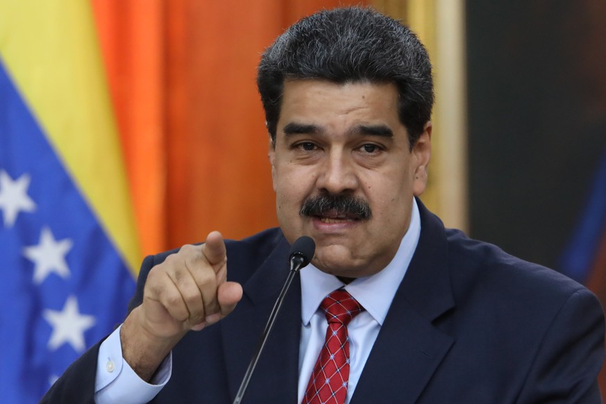 epa07319367 Venezuelan president, Nicolas Maduro, speaks during a press conference from Miraflores Palace, in Caracas, Venezuela, 25 January 2019. Maduro said that the international media that have covered the crisis in the country have 'invisibilized' the Chavista 'force' that has supported him in what he considers a 'coup d'état' led by the president of Parliament, Juan Guaido -who has clained the interim Presidency of the country - and who he said is an 'agent of the yankees'.  EPA/Cristian Hernandez