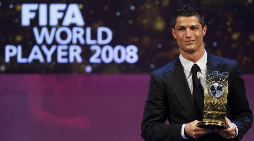 Soccer player Cristiano Ronaldo from Portugal poses with the trophy after being named FIFA World Player of the Year during the FIFA World Player Gala 2008 at the Opera house in Zurich, Switzerland, Monday, January 12, 2009. (KEYSTONE/Steffen Schmidt)