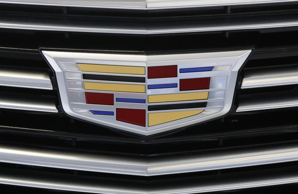 FILE - This Thursday, Feb. 11, 2016, file photo shows the Cadillac logo, a General Motors Co. brand, on display on a vehicle at the Pittsburgh International Auto Show in Pittsburgh. The U.S. government