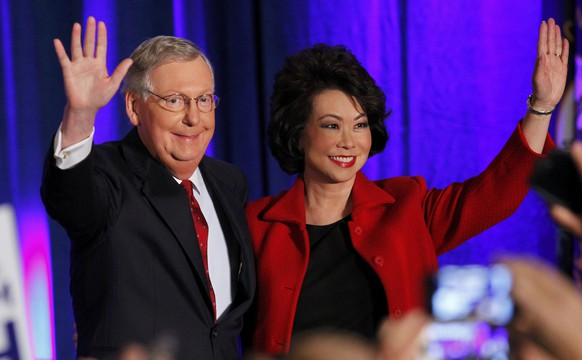 U.S. Senate Minority Leader Mitch McConnell (R-KY) waves to supporters with his wife, former United States Secretary of Labor Elaine Chao, at his midterm election night rally in Louisville, Kentucky, November 4, 2014.  Television news networks are projecting that McConnell will win the election.     REUTERS/John Sommers II (UNITED STATES  - Tags: POLITICS ELECTIONS)