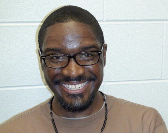 epa08875725 An undated handout photo made available by the defense team of Brandon Bernard shows federal inmate Brandon Bernard as he sits on death row awaiting his scheduled execution in Terre Haute, Indiana, USA, Issued 10 December 2020. Bernard was convicted for the 1999 carjacking and killing of Todd and Stacie Bagley on the Fort Hood Army base near Killeen, Texas, USA. Bernard is scheduled to die by lethal injection at the US Penitentiary on 10 December 2020.  EPA/DEFENSE TEAM OF BRANDON BERNARD / HANDOUT  HANDOUT EDITORIAL USE ONLY/NO SALES