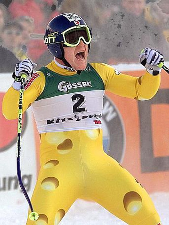 Didier Cuche of Switzerland, winner of the men's World Cup sprint downhill in Kitzbuehel, Austria, celebrates his victory, Friday, January 23 1998. (AP Photo/Rudi Blaha) === ELECTRONIC IMAGE ===