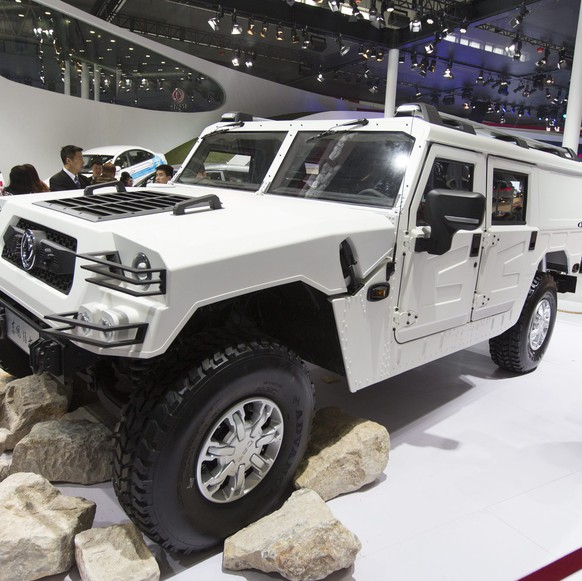 epa04173272 An SUV reminiscent of US General Motors recently discontinued Hummer is shown by China's Dongfeng Auto as Auto China 2014 opens for media day at the China International Exhibition Center in Beijing, China, 20 April 2014. All the main car manufacturers from China and overseas participate in the show which aims to introduce new models in the world's largest auto market. The event will open to the public on 21 April 2014.  EPA/ADRIAN BRADSHAW