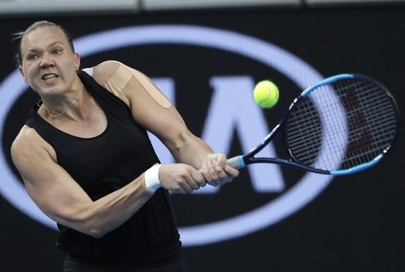 Estonia's Kaia Kanepi hits a backhand return to Romania's Simona Halep during their first round match at the Australian Open tennis championships in Melbourne, Australia, Tuesday, Jan. 15, 2019. (AP Photo/Mark Schiefelbein)