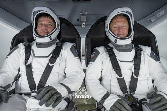 epa08580085 (FILE) - A handout picture made available by SpaceX shows NASA astronauts Bob Behnken (L) and Doug Hurley participating in a fully integrated test of SpaceX Crew Dragon flight hardware at the SpaceX processing facility on Cape Canaveral Air Force Station in Florida, USA, 30 March 2020 (issued 02 August 2020). Carrying NASA astronauts Robert Behnken and Douglas Hurley, Endeavour is scheduled to splash down in the Gulf of Mexico on 02 August. The pair launched to the International Space Station (ISS) on 30 May 2020, in the first commercially built spacecraft to carry people into orbit.  EPA/SPACEX HANDOUT  HANDOUT EDITORIAL USE ONLY/NO SALES