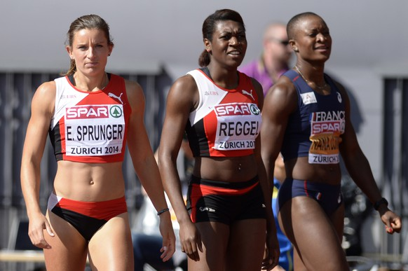 Ellen Sprunger from Switzerland, left, stands next to her compatriot Valerie Reggel, and Antoinette Nana Djimou from France, right, after the women's 100m hurdles race of the heptathlon competition, at the third day of the European Athletics Championships in the Letzigrund Stadium in Zurich, Switzerland, Thursday, August 14, 2014. (KEYSTONE/Jean-Christophe Bott)