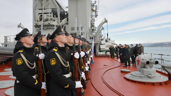Russian seamen stand in line on the Marshal Ustinov during naval maneuvers in the Black Sea, Crimea, Thursday, Jan. 9, 2020. The drills involved warships and aircraft that launched missiles at practice targets. (Alexei Druzhinin, Sputnik, Kremlin Pool Photo via AP)