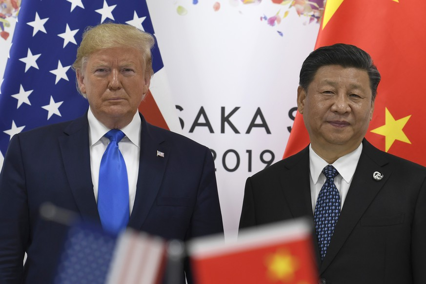 President Donald Trump, left, poses for a photo with Chinese President Xi Jinping during a meeting on the sidelines of the G-20 summit in Osaka, Japan, Saturday, June 29, 2019. (AP Photo/Susan Walsh) Donald Trump,Xi Jinping