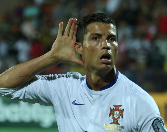 Portugal's Cristiano Ronaldo gestures after scoring the second goal during the Euro 2016 Group I qualifying match between Armenia and Portugal in Yerevan, Armenia, Saturday, June 13, 2015. (Hrant Khachatryan/PAN Photo via AP)