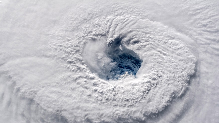 epa07015144 A handout photo made available by the NASA on 12 September 2018 shows the eye of category 4 hurricane Florence over the Atlantic, 12 September 2018.  Hurricane Florence is a category 4 storm on the Saffir-Simpson Hurricane Wind Scale, with winds topping 165 miles per hour. No category 4 hurricane has ever made landfall in North Carolina.  EPA/ESA/NASA-ALEXANDER GERST / HANDOUT MANDATORY CREDIT: ESA/NASA–A. Gerst HANDOUT EDITORIAL USE ONLY/NO SALES