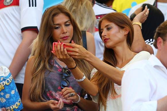 RIO DE JANEIRO, BRAZIL - JULY 04: Ann-Kathrin Brommel (L), girlfriend of Mario Gotze of Germany, and Cathy Fischer, girlfriend of Mats Hummels of Germany, look on during the 2014 FIFA World Cup Brazil Quarter Final match between France and Germany at Maracana on July 4, 2014 in Rio de Janeiro, Brazil.  (Photo by Martin Rose/Getty Images)